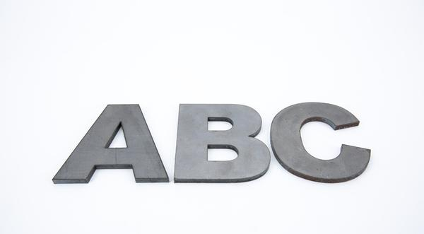 Laser cut hot roll steel letters of the alphabet